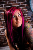 Attractive tattooed girl studio portrait royalty free stock image