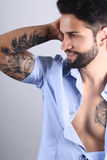 Attractive tattooed man posing Royalty Free Stock Photography