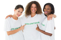 Attractive team of volunteers smiling at camera. On white background Royalty Free Stock Image