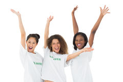 Attractive team of volunteers waving at camera Royalty Free Stock Photos