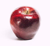 Attractive teasing red apple close up isolated on Royalty Free Stock Photography