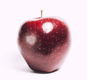 Attractive teasing red apple close up isolated on Stock Photography