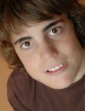 Attractive teen boy. Face shot of serious looking attractive teen model Royalty Free Stock Photos