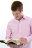 Attractive Teen Boy with Book. Attractive seventeen year old boy with open book Stock Photo