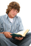 Attractive Teen Boy Reading Book Royalty Free Stock Photos
