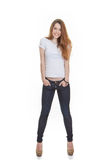 Attractive teen fashion model posing. In jeans and t shirt Stock Photo