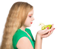 Attractive teen girl in a green t-shirt holding carving green ap Stock Photography