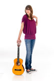 Attractive Teen girl guitar. Attractive 15 year teen girl with guitar. Studio, white background Stock Image
