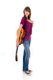 Attractive Teen girl guitar. Attractive 15 year teen girl with guitar. Studio, white background Stock Photo