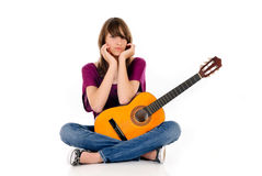 Attractive Teen girl guitar. Attractive 15 year teen girl with guitar. Studio, white background Stock Photos