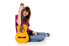 Attractive Teen girl guitar. Attractive 15 year teen girl with guitar. Studio, white background Royalty Free Stock Photos