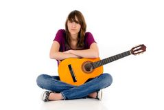 Attractive Teen girl guitar. Attractive 15 year teen girl with guitar. Studio, white background Royalty Free Stock Photography