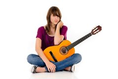 Attractive Teen girl guitar. Attractive 15 year teen girl with guitar. Studio, white background Stock Photography