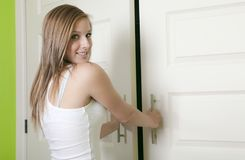 Attractive teen girl open closet Stock Photos