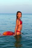 Attractive teen girl in the sea Stock Photography