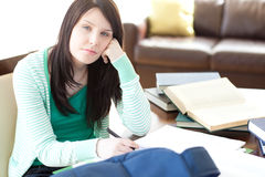 Attractive teen girl studying Royalty Free Stock Image