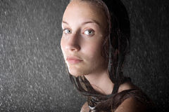 Attractive teen girl in water studio close up. Portrait Stock Photography