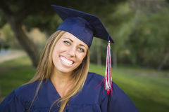 Attractive Teen Graduate Wearing Cap and Gown Outdoors Stock Photos