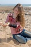 Attractive teen on seashore royalty free stock photo