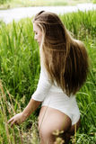 Attractive Teen Woman Standing In Grass At River Royalty Free Stock Photos