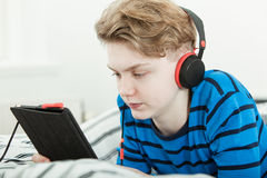 Attractive teenage boy listening to music Stock Image