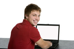 Attractive teenage boy using a lap top Royalty Free Stock Photos