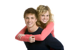 Attractive teenage couple, piggy back ride Stock Image