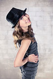 Attractive teenage girl in black hat Royalty Free Stock Photos