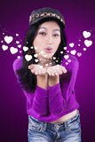 Attractive teenage girl blowing kiss Royalty Free Stock Photo
