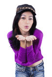Attractive teenage girl blowing kiss Stock Photo