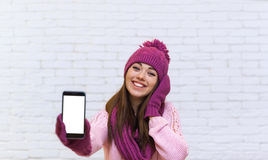 Attractive Teenage Girl Displaying Cell Smart Phone Touch Screen Empty Space Royalty Free Stock Images