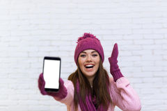 Attractive Teenage Girl Displaying Cell Smart Phone Touch Screen Empty Space Royalty Free Stock Photo