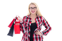 Attractive teenage girl  in eyeglasses with shopping bags isolat Stock Image