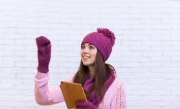 Attractive Teenage Girl Hand Gesture To Copy Space Using Tablet Laptop Touch Screen royalty free stock photos