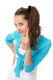 Attractive teenage girl with her finger up Stock Photography