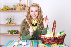 Attractive teenage girl painting easter eggs Royalty Free Stock Photo