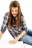 Attractive teenage girl reading a book Royalty Free Stock Photos