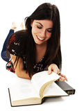 Attractive teenage girl reading book Royalty Free Stock Photography