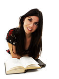 Attractive teenage girl reading book Royalty Free Stock Images