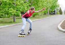 Attractive teenage girl roller skating at speed Royalty Free Stock Images