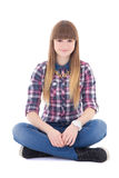 Attractive teenage girl sitting isolated on white. Background stock photography