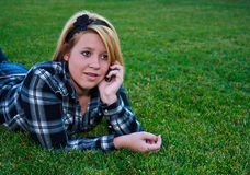 Attractive teenage girl talking on a cell phone Stock Photography