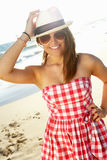 Attractive Teenage Girl Wearing Dress On Beach Stock Images
