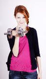 Attractive teenage girl working-out with dumbbell Royalty Free Stock Photos