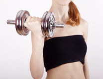 Attractive teenage girl working-out with dumbbell Stock Photography