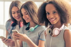Attractive teenage girls with gadgets Royalty Free Stock Image
