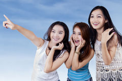 Attractive teenage girls looking at copyspace Stock Photography