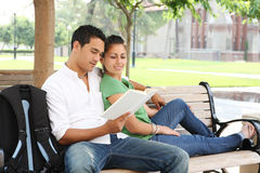 Attractive Teenage Students at College Reading Royalty Free Stock Photo
