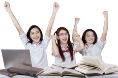 Attractive teenage students expressing success Royalty Free Stock Images