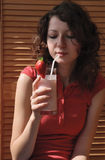 Attractive teenager girl drinking milk cocktail Royalty Free Stock Photos